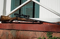 Pete Ryan's restored 7 x 57 (bottom) on the verandah of Cecil Rhodes's Shooting Box, in the Rooipoort Nature Reserve.