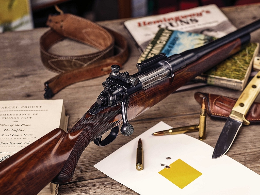 Favoring the Griffin & Howe's trim, iron-sighted carry, the author uses the precisely made Lyman 48 receiver sight where hunting conditions favor aging eyes.